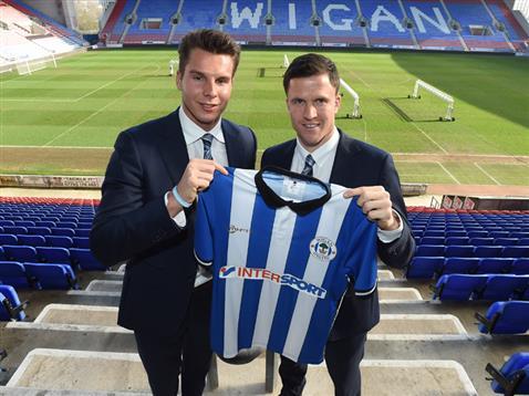 Wigan's Chairman David Sharpe and manager Gary Caldwell